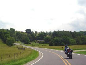 "Photo - motorcycle on a Virginia section with caption ""Never rush the Parkway - it's meant to be savored""."