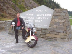 Photo - Wayne and his bike pose at the highest point on the Blue Ridge Parkway