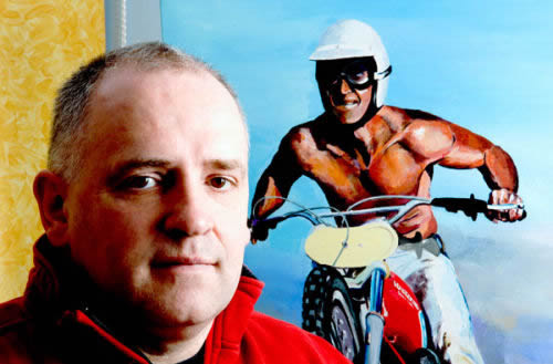 Photo - Rob Kinsey with one of his motocross paintings
