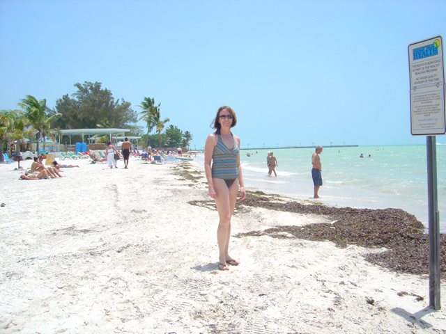 Photo-Jackie-at-the-southernmost-beach-in-Key-West