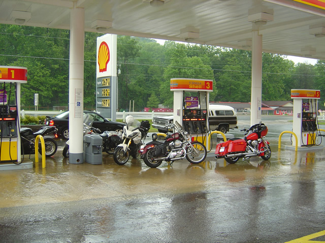 Photo-motorcycles-shelter-from-rain-at-gas-station