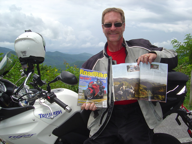 Photo - Wayne from America Rides Maps with copies of Road Bike Magazine
