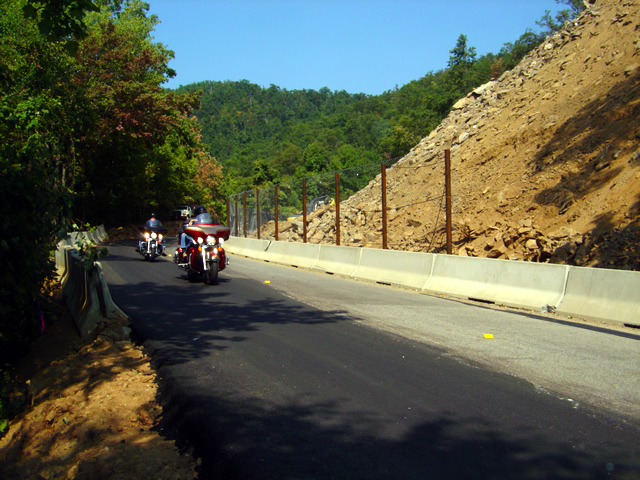 Photo - motorcycles pass the rock slide on the Blue Ridge Parkway