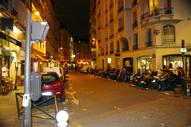 photo - motorcycle parked along a Paris Street