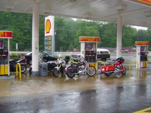 Photo - Motorcycles shelter from rain at gas station