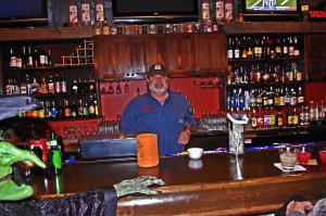 photo - Brad Betters tends the bar at the Lodge at Copperhead