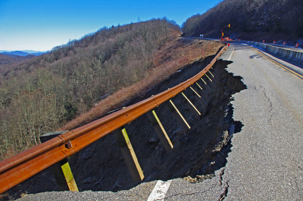 Landslide on the Cherohala Skyway - The guardrail hangs dramatically
