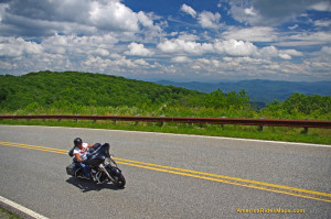 Motorcycle flying through the mile high curves on the Cherohala Skyway